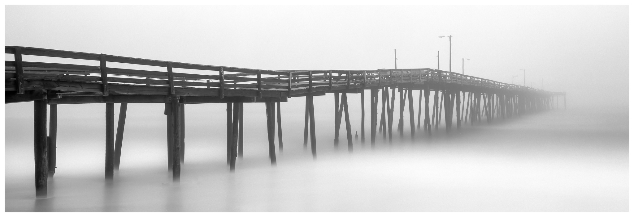 Nags Head Fishing Pier - Fuji GX617 w/105mm lens on Fuji ACROS film, long exposure with tide coming in.