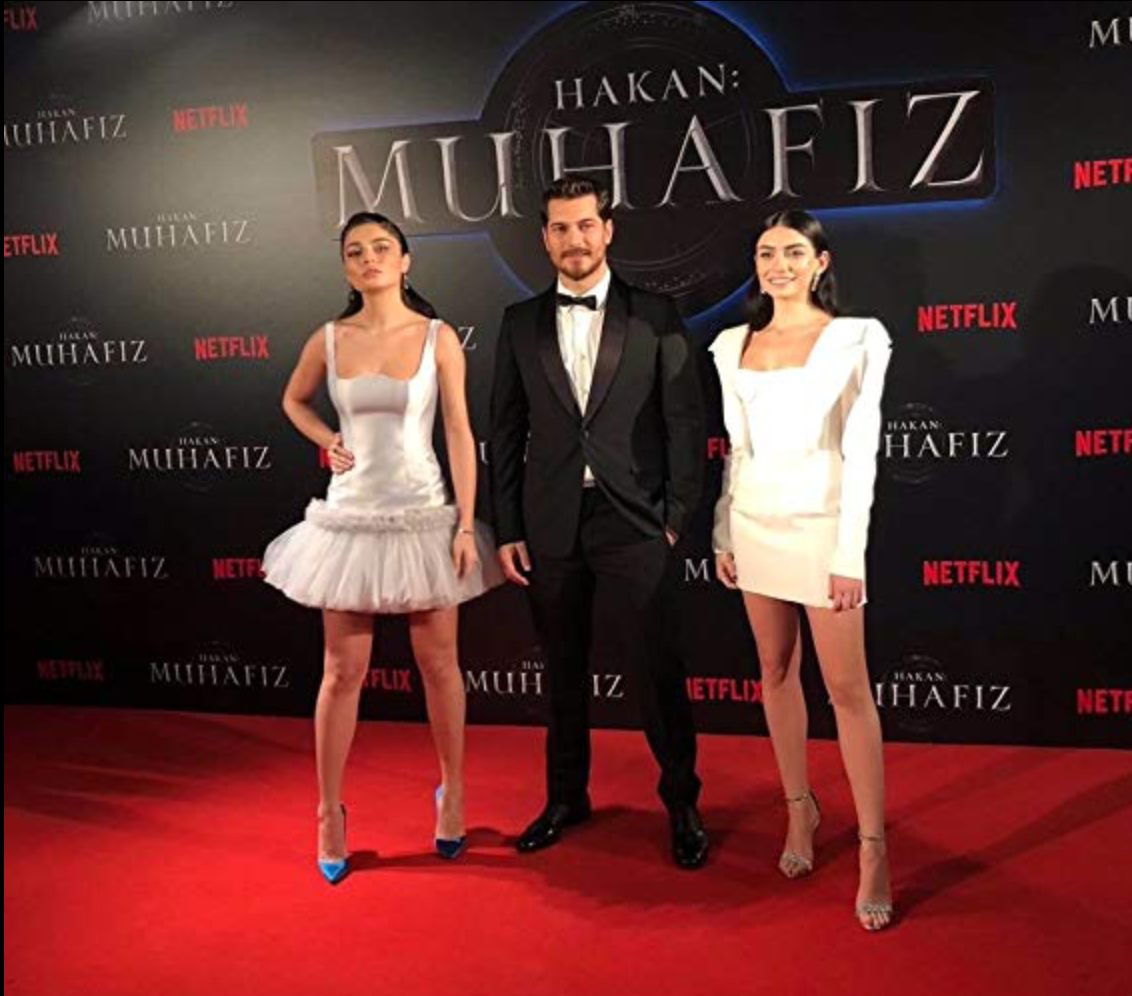 """Hazar alongside fellow cast members Çagatay Ulusoy, and Ayça Aysin Turan, at the Premiere of """"The Protector""""."""