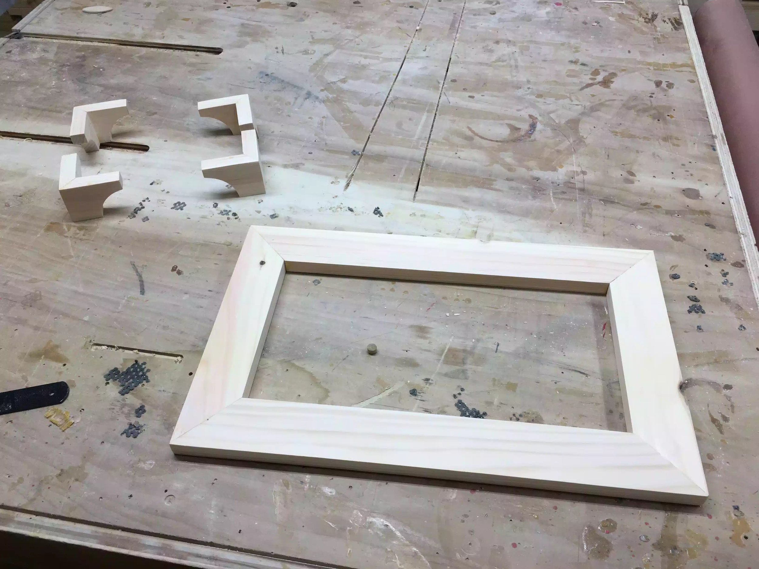 Here is the mitered frame I made using biscuit joints, the bracket feet are attached to the bottom of this frame.