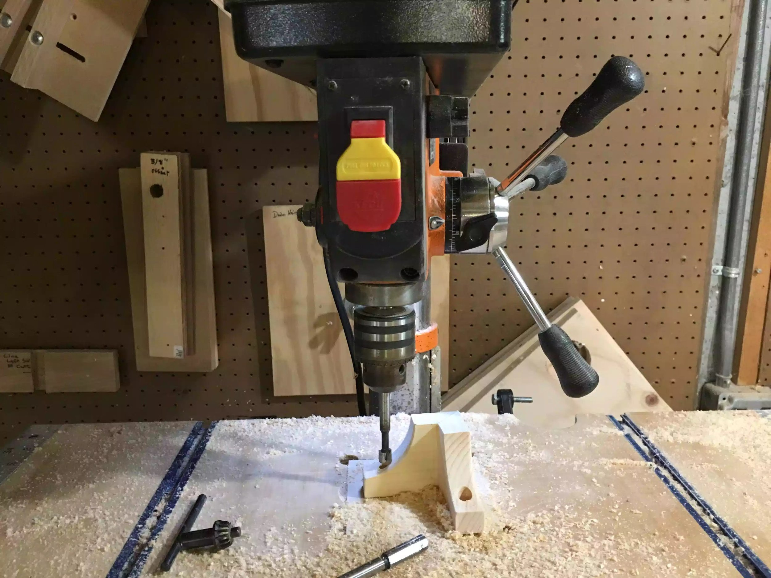 "Here is my drill press with a 3/8"" forstner bit preparing to drill the hole"