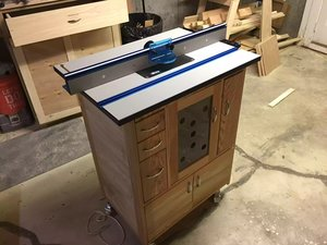 Here is home made router table with the Kreg router table and fence.