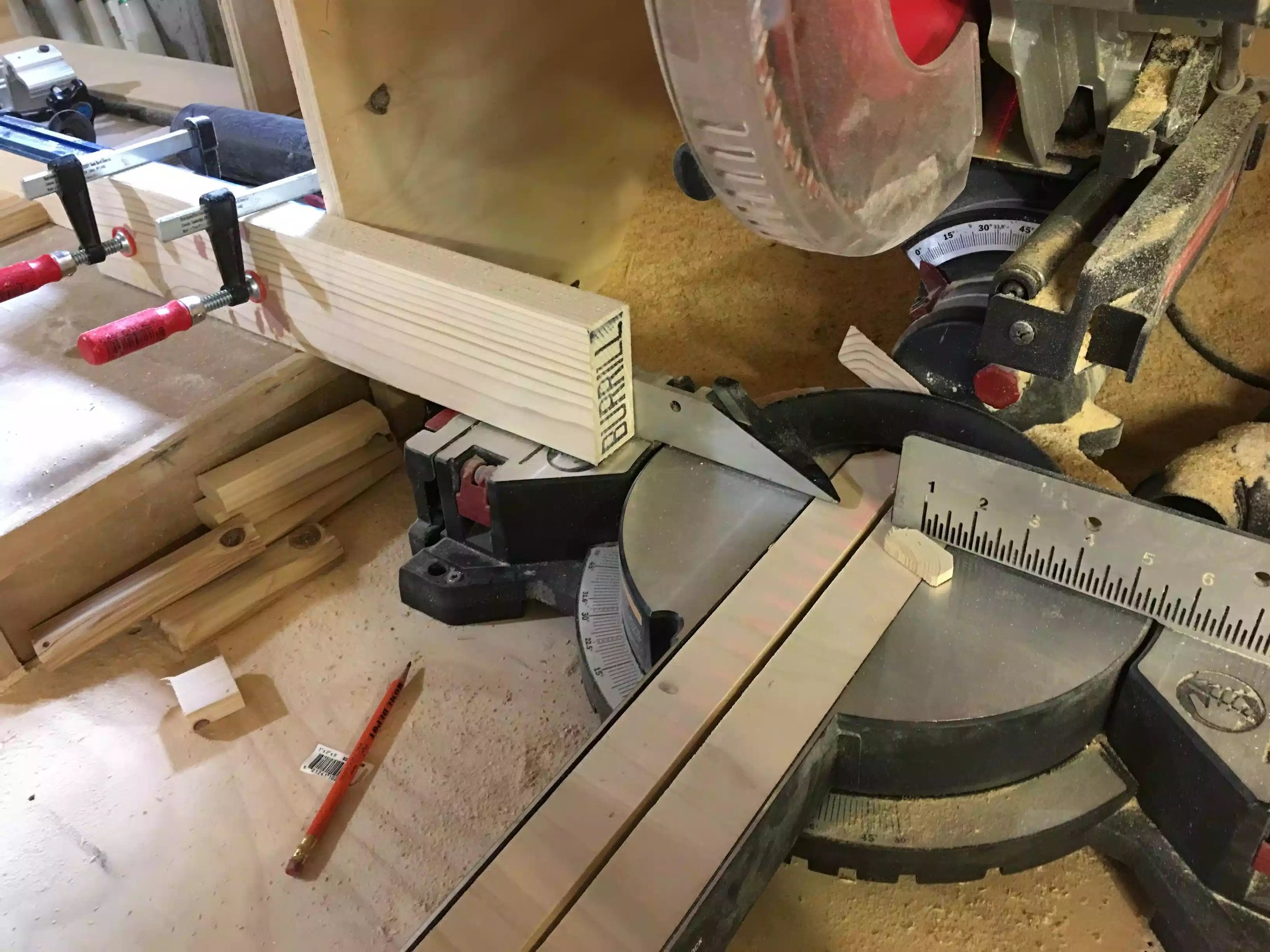 Here is my temporary stop block which is set 6'' from the blade in my Miter Saw station.