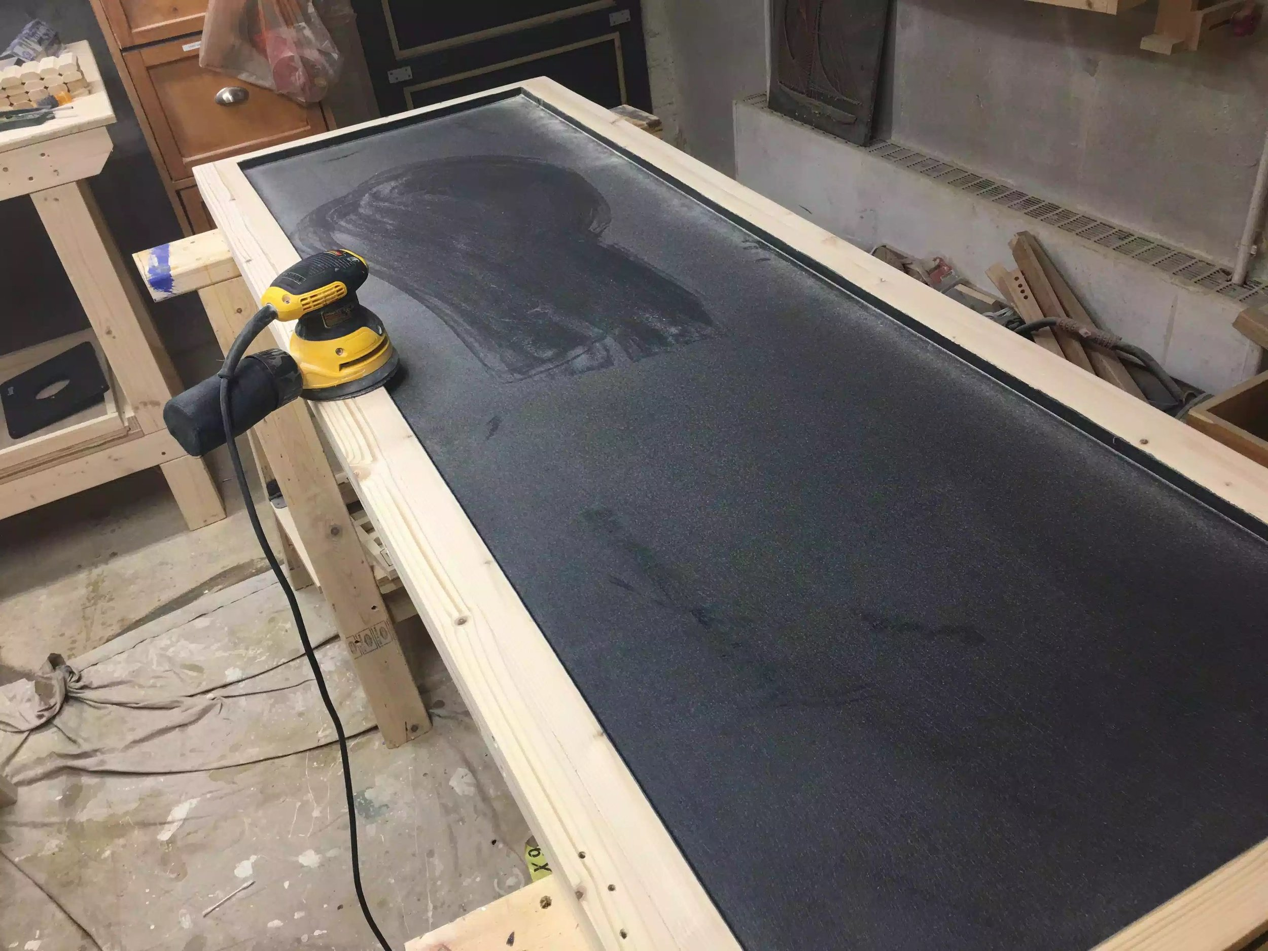 Here I am using my orbital sander after the paint had dried, as you can see it created a lot of dust build up on the panel, so I just vacummed that up and wiped it down with a damp rag. I sanded it as before from 80 grit - 220 grit