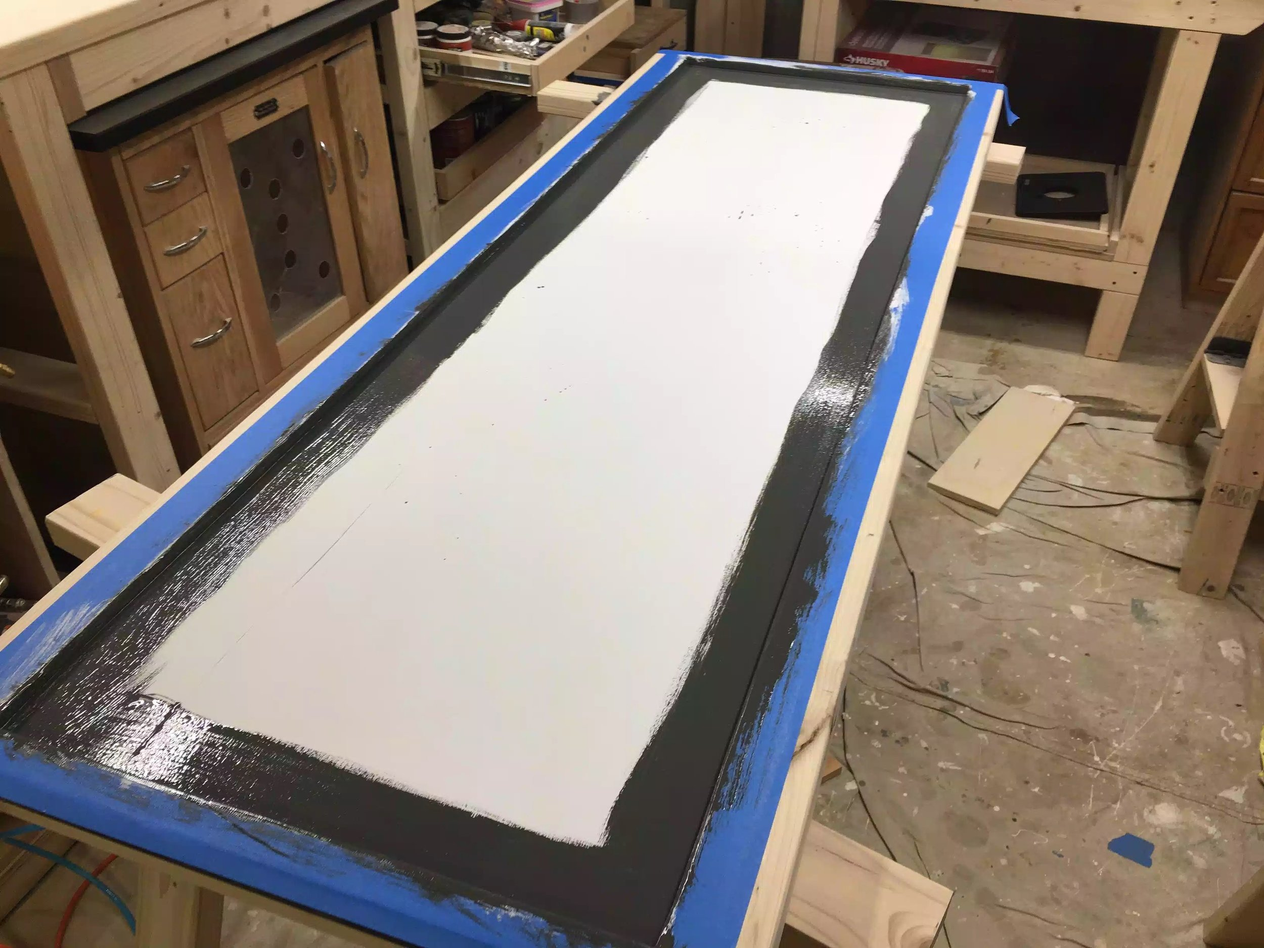 I used a brush to cut the paint into the sides and then came back with a roller to do the rest of the panel
