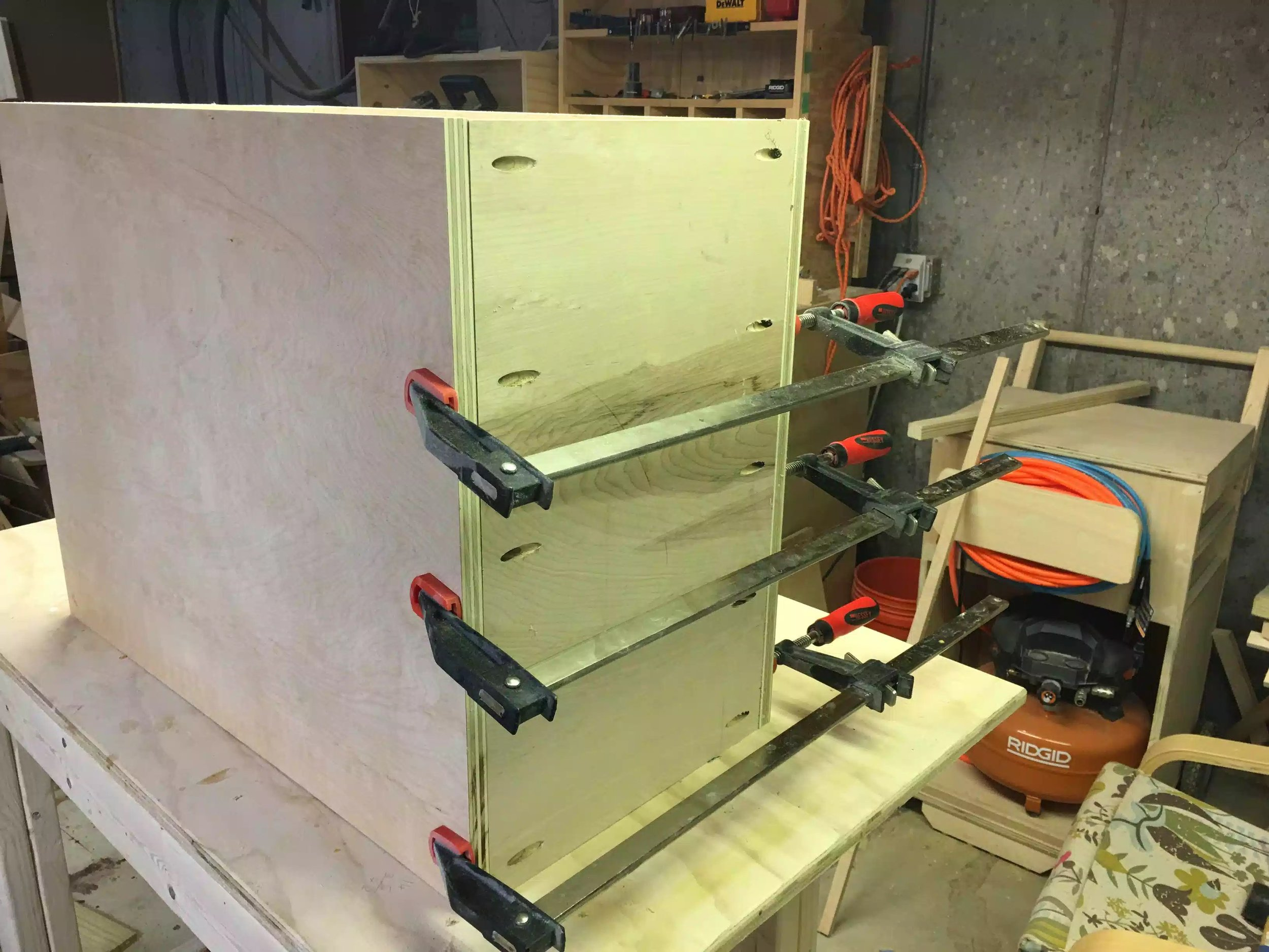 Here you can see the actual base of the cabinet being clamped together getting ready for the pocket hole screws to be inserted.