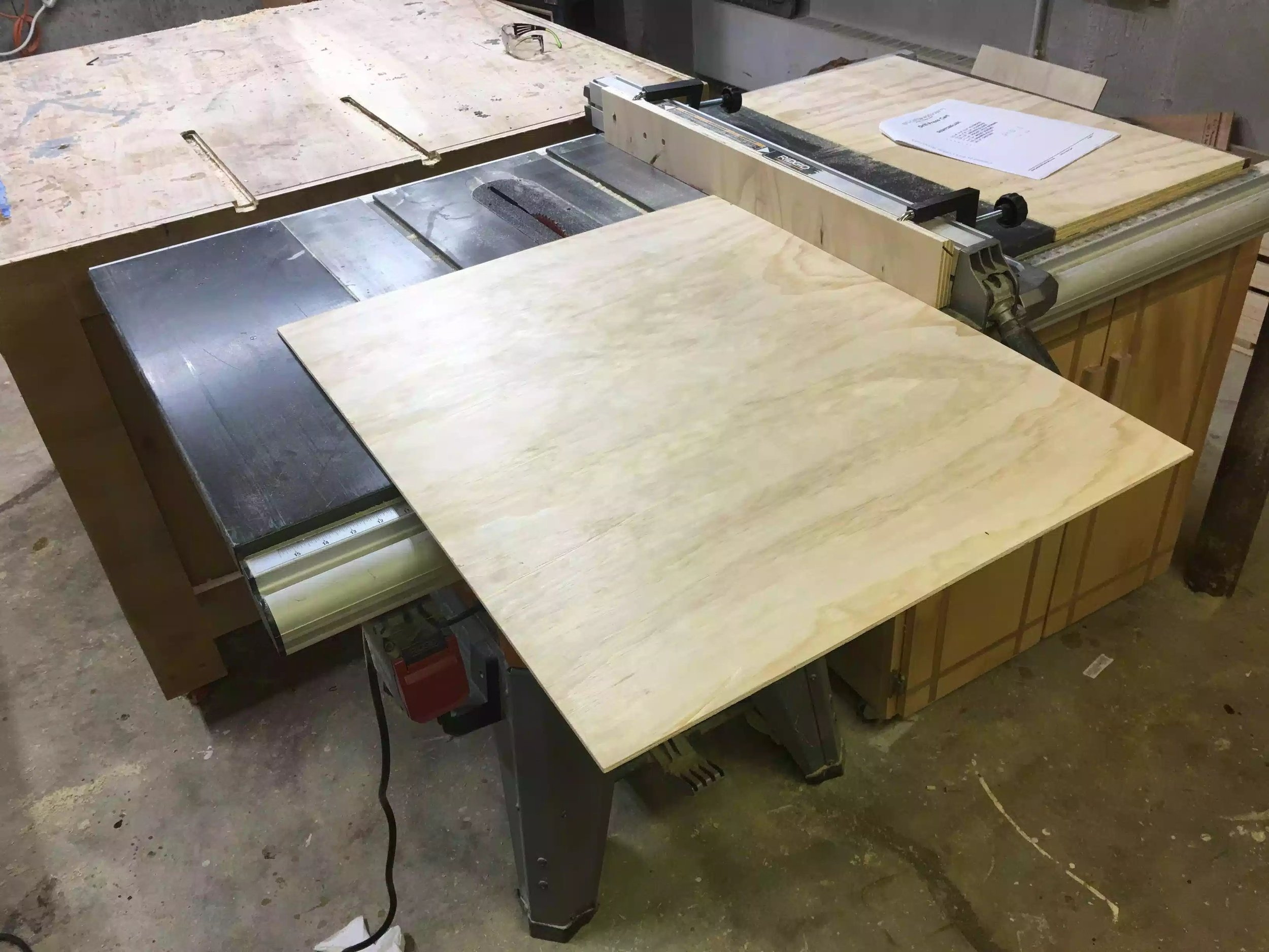 Here I am getting ready to rip the back panel to size on my table-saw