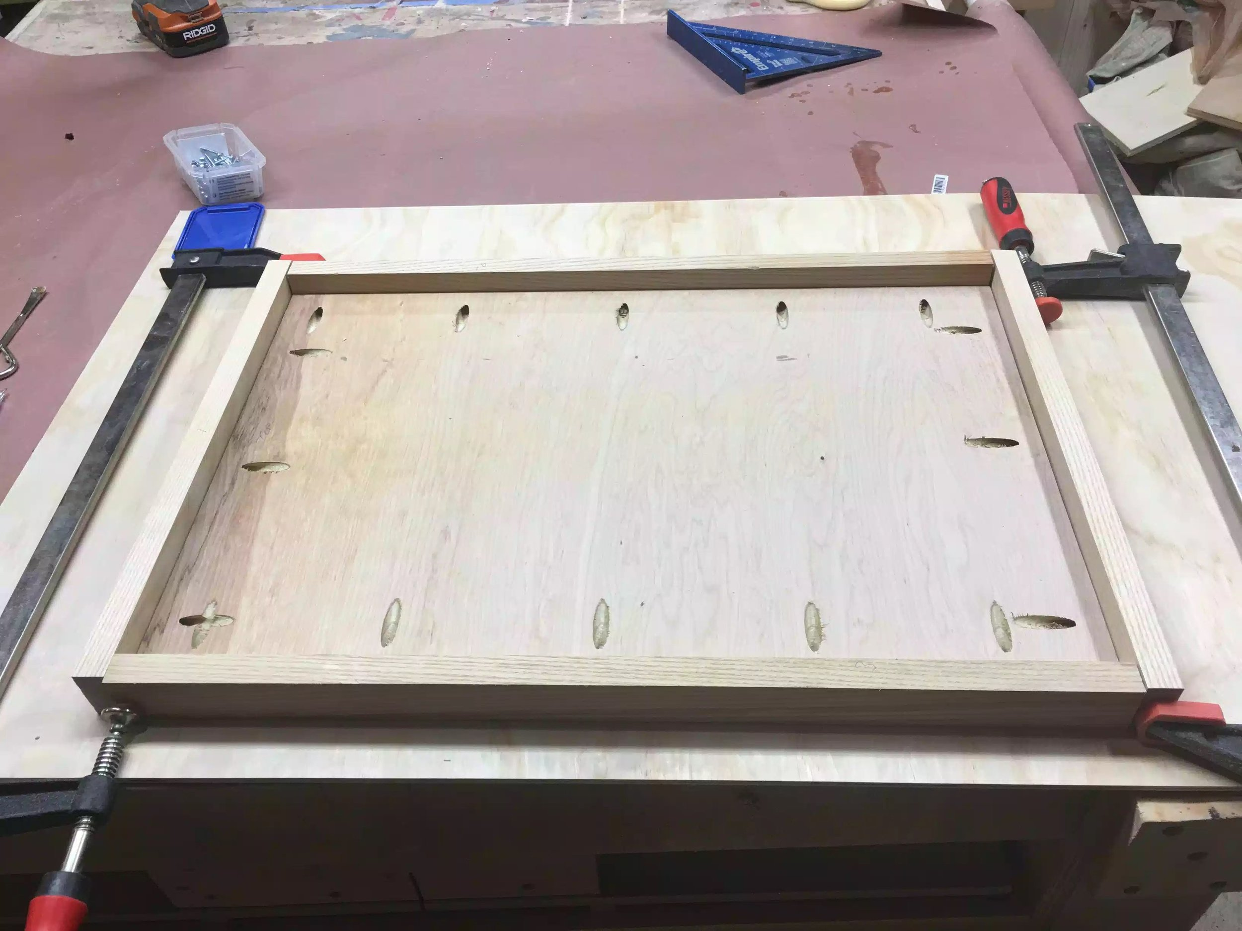 Here you can see the underside of the top, its all clamped up and the hardwood is ready to be added. I still need to add the cleats to the left & right of the panel so as that I can attach it to the cabinet.