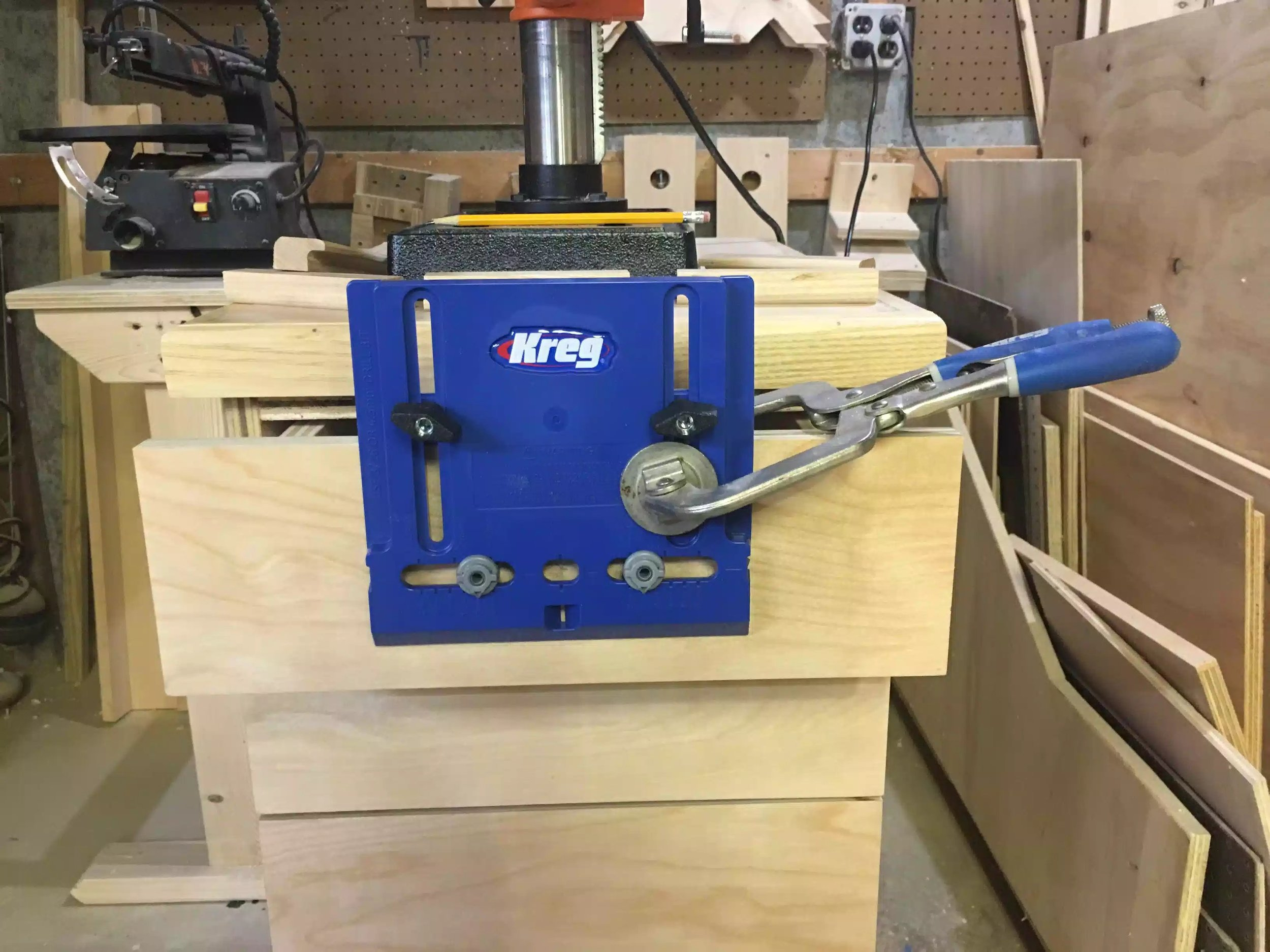 "Here is the jig that I clamped to the drawer fornt, I made a measurement finding the center of the drawer and then I use a 5/16"" drill bit to drill throught the drawer and then add screws to secure the pull."