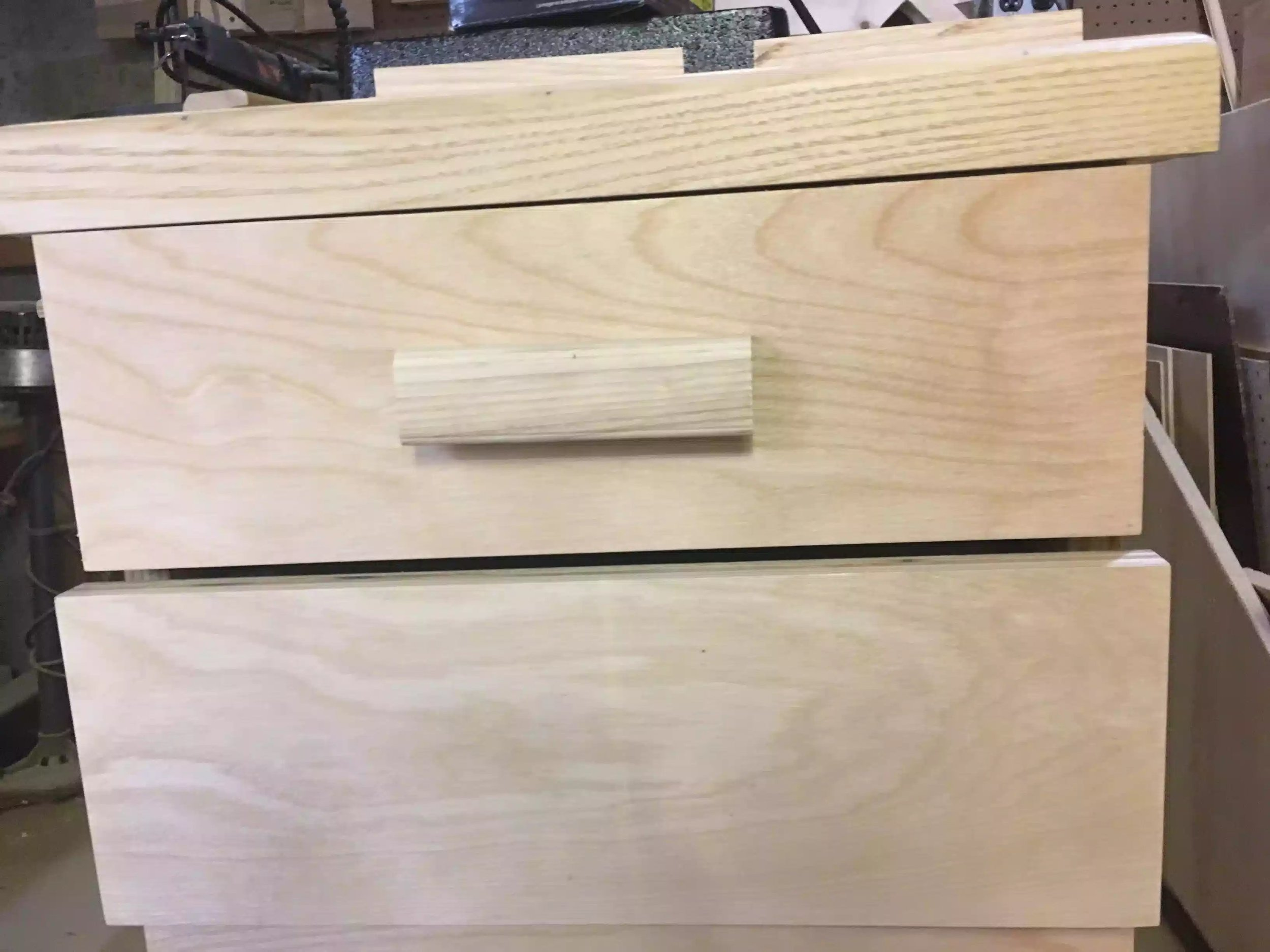 Here is the first drawer pull installed and I have to say that the pulls look awesome and match the solid edge banding on the cabinet top.