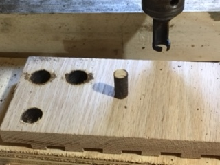 Cutting the plugs on the drill press.