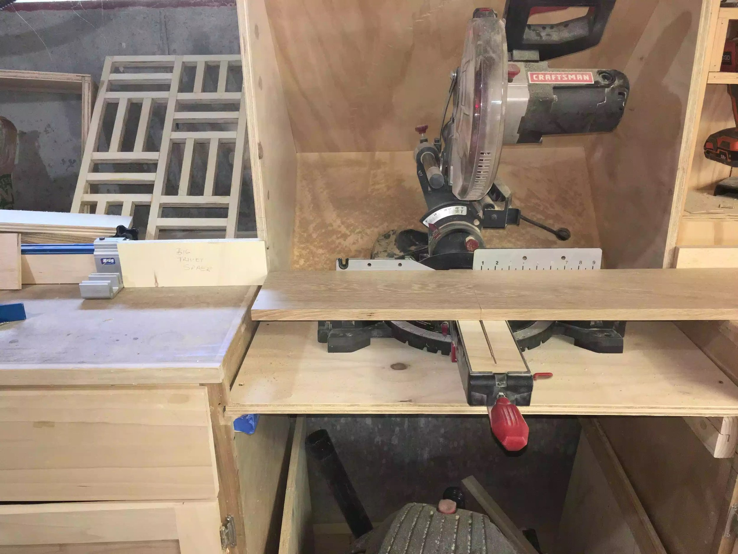 Here you can see the oak sitting on the miter saw deck and the spacer block is establishing the positive that I need to make all cuts the same size.