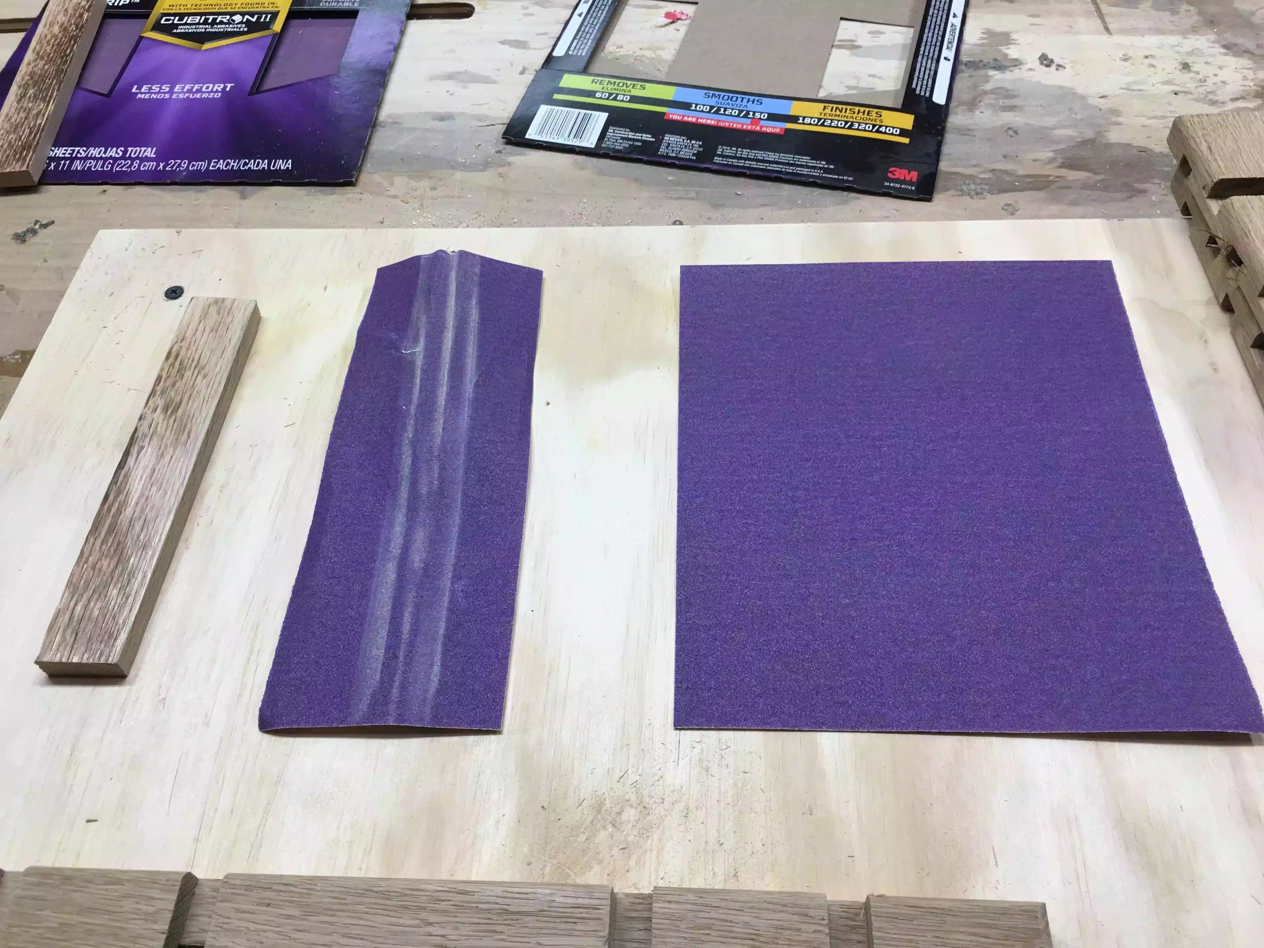 """Here are my aids, 3/8"""" thick scrap piece of wood that I used to wrap the sandpaper onto and moves in and around all the grooves with ease."""