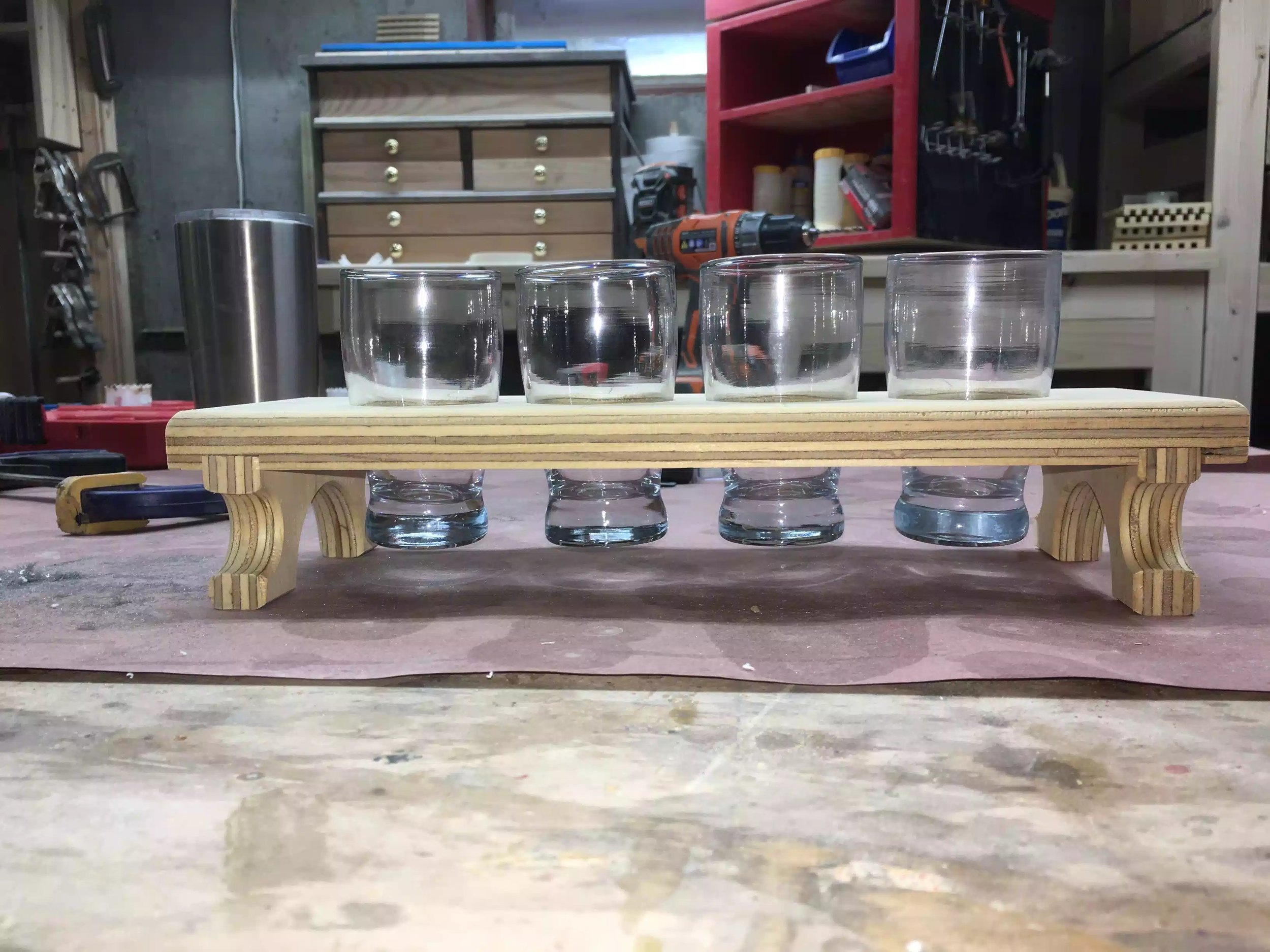 "Frontal picture showing the glasses in there homes, there is about 1"" clearance from the glasses to the table-top. Love the dado joint."