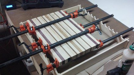 "As you can see its a front and back rail with stretchers on either side, he notched out half circles to accommodate the pipe clamps, The stretchers are help together using a half-lap joint and when not in use can be just pulled up and the jig can be stored away.I think I will make mine the same but I will add different sized stretcher depending the size of clamps I will be using, they usually range from 12"" - 36"". Click  here  for the website I found this on."
