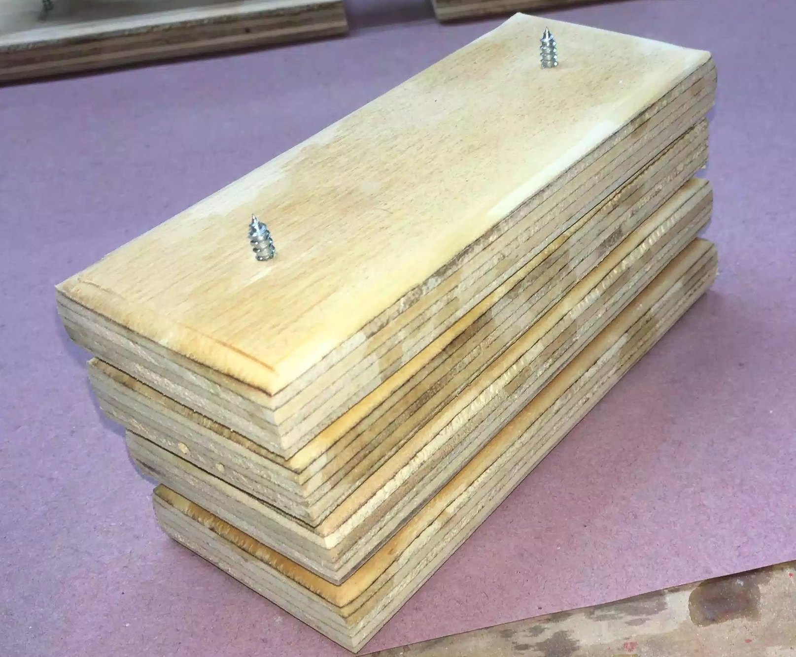 Here is a few stacked, makes storage easy. As you can see on one I have screws protruding through the top, this is what your work piece sits on while applying the finish.