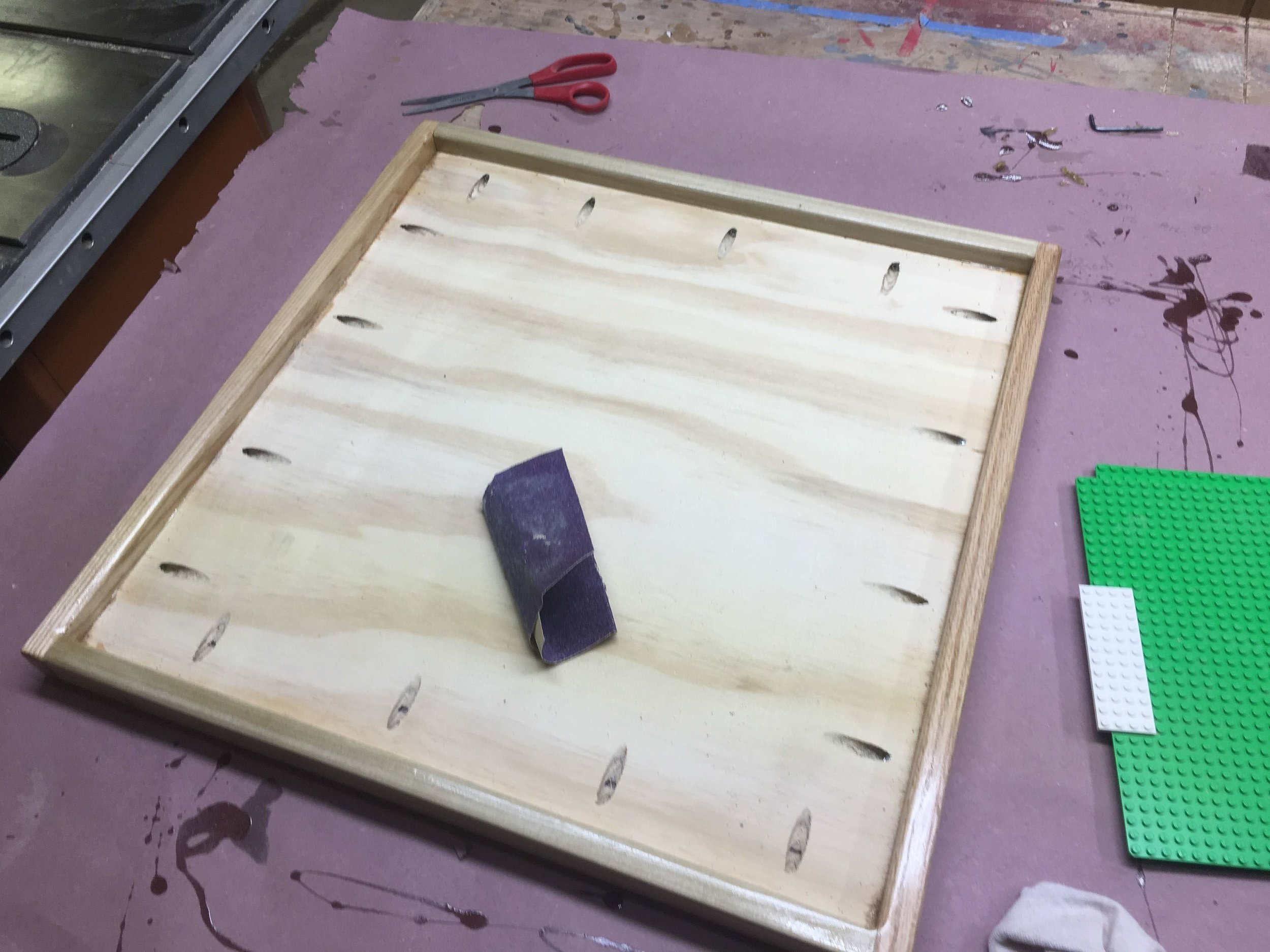Here is me doing the same to the plywood base.
