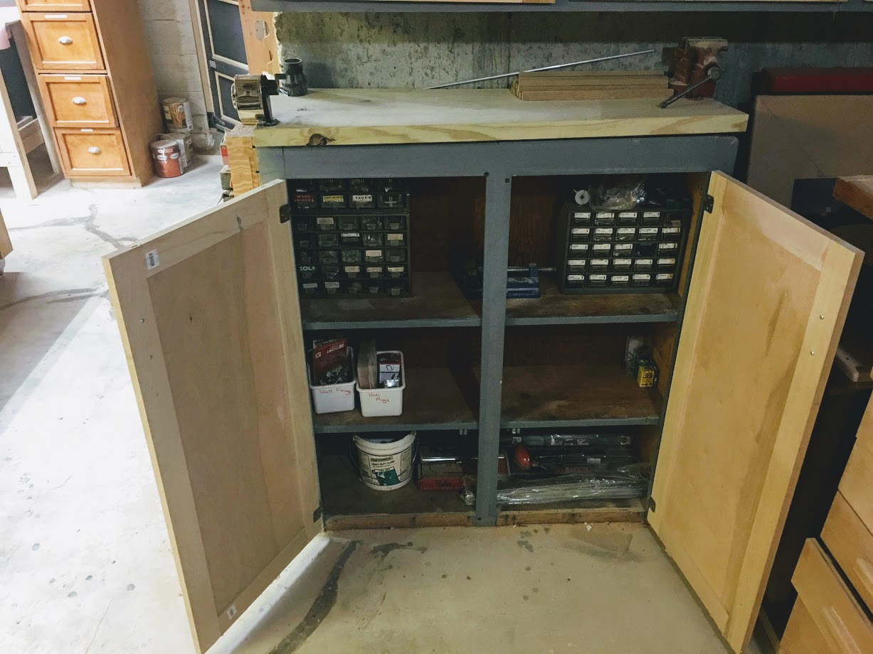 Here is a cabinet on the floor and here is where I keep my miscellaneous items like little organizer bins for all my nuts an bolts. I designed and made all the cabinet doors