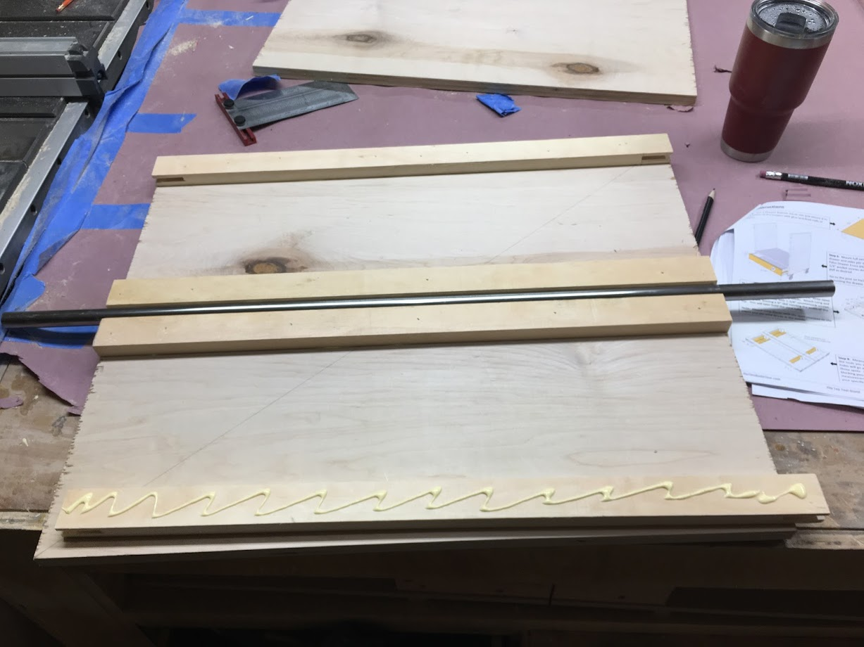 In this picture I am gluing the longest pieces in position there are 4 long pieces that I need to glue and screw to the plywood panel.