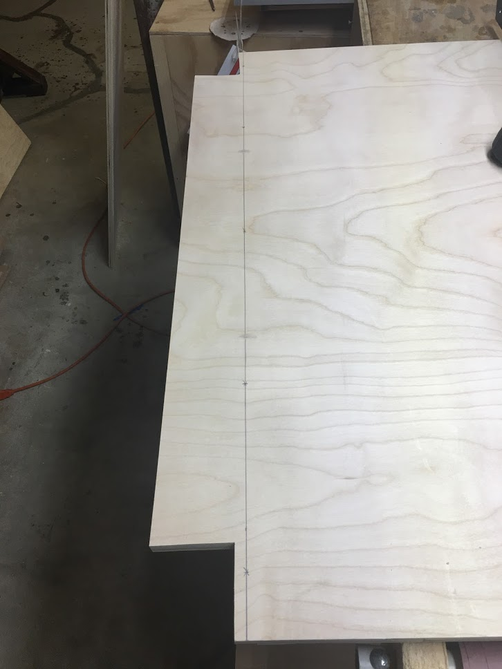"""Although Marc Spagnulo didn't add screws to secure the base I will be using screws and glue, this line indicates the center line of the dado I will be counter-sinking 1-1/4"""" screws into this outside face of the panel I will also come back later and plug the holes with probably oak plugs."""
