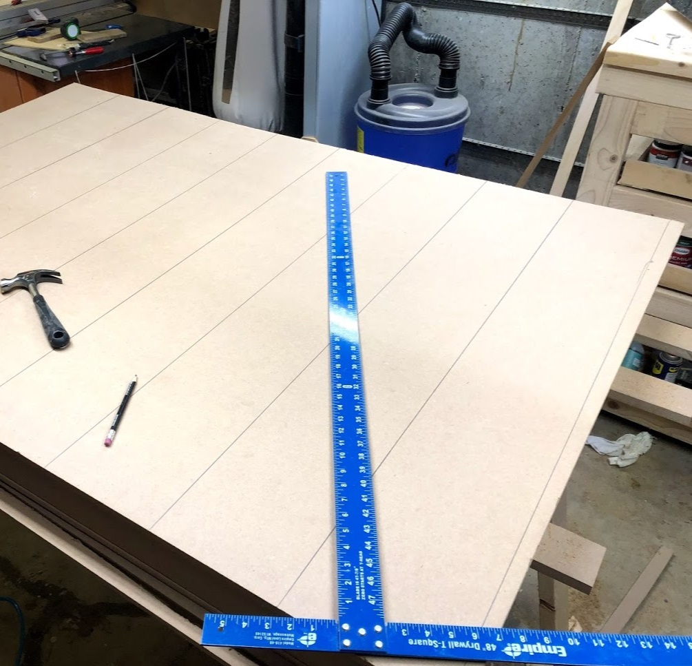 Using my drywall framing ruler I draw visible lines to show here my grid pieces were located, that way I could anchor the top with brad nails .