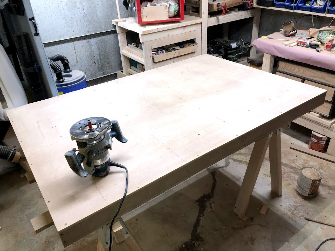 After the skin is installed I also added a few screws and then using my router I flush trimmed the top making sure that all edges lines up.. I will be attaching my solid wood trim to the outside of the torsion box by the end of the project.