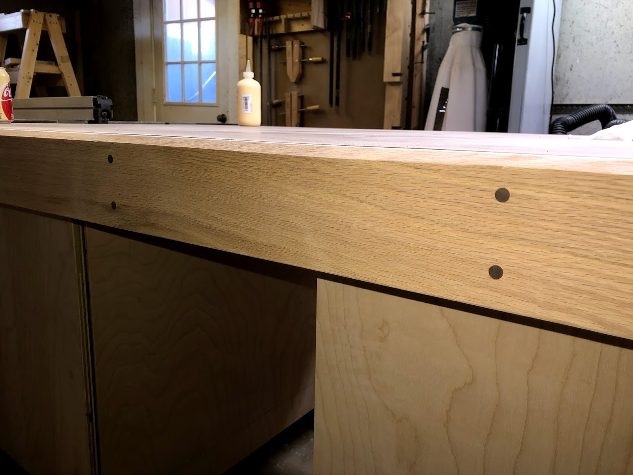 Dowels are flush cut and sanded smooth and really like the look.