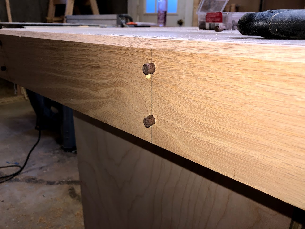 Here is the walnut dowel left proud, just waiting for the glue to dry.