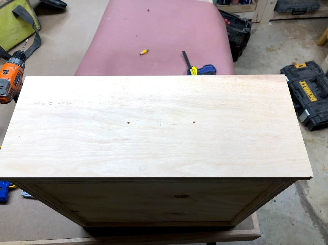 Holes predrilled, all that was left was to secured the pulls with 2 screws from the inside of the drawer.