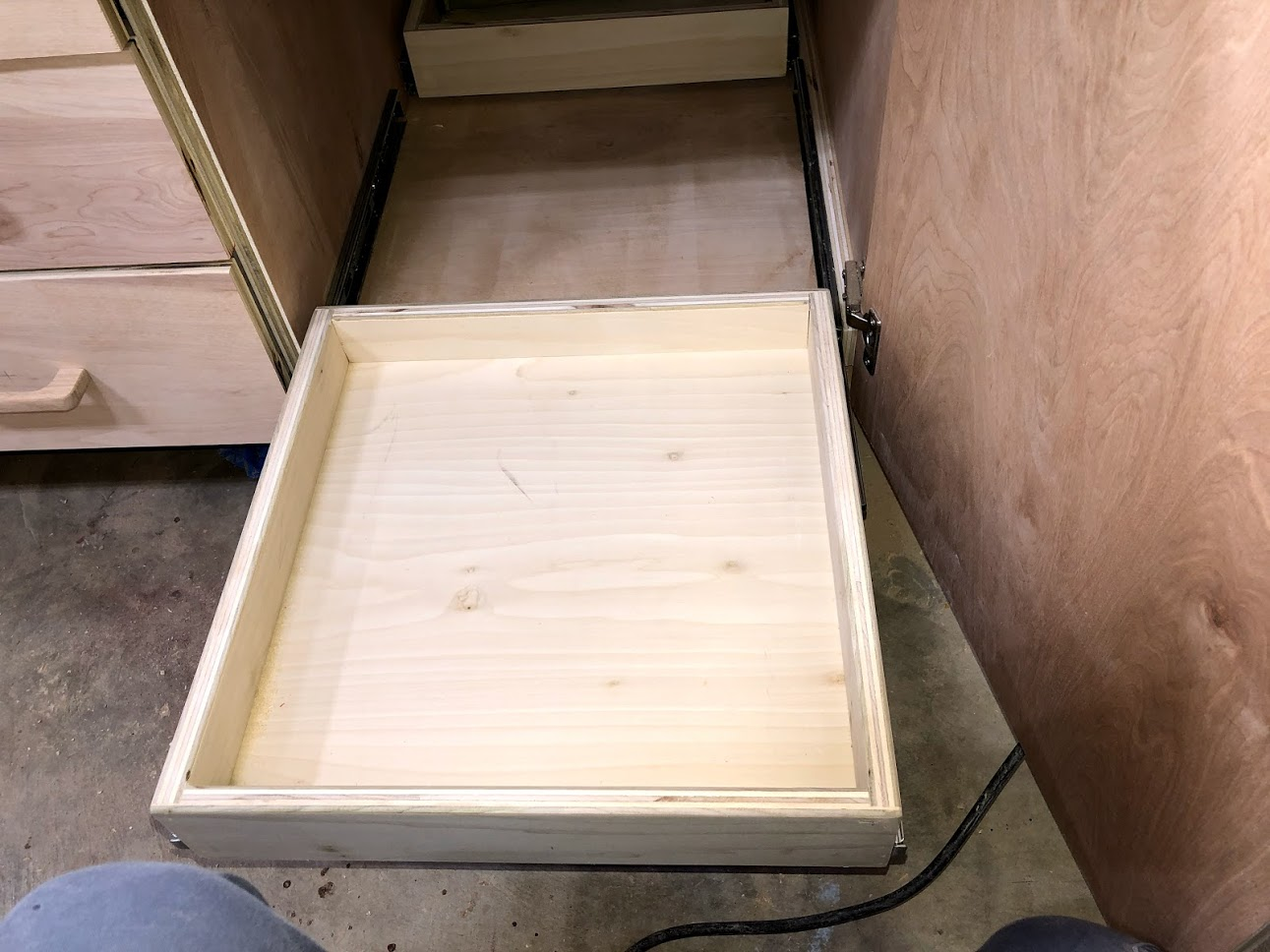 Since the tray operate on drawer slides it allows me easy access to the back of the tray