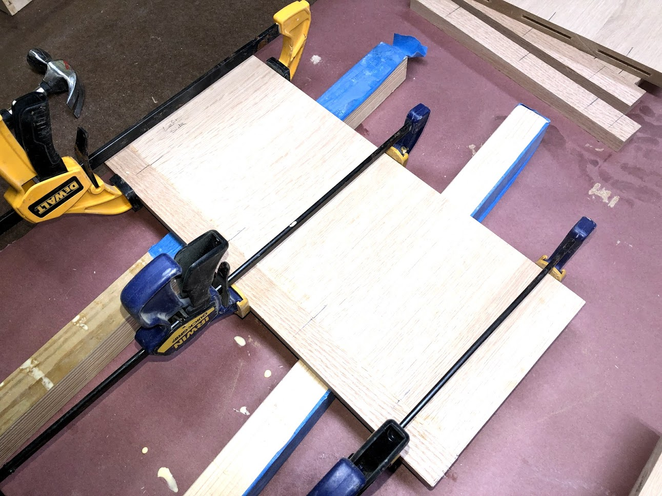 Here is the side receiving its solid oak edge banding and getting clamped up.