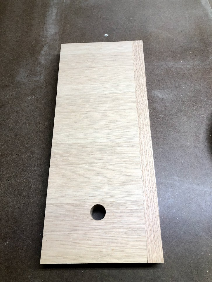"Here is the side after the hole is cut, this will receive the 3/4"" diameter dowel later and hold the paper towel in place."