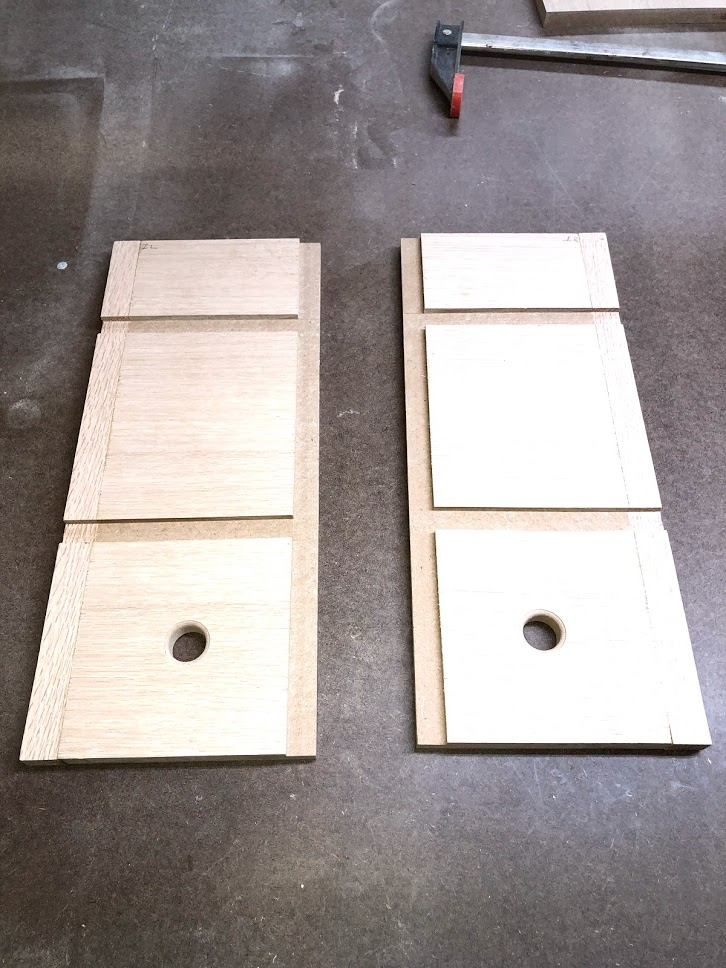 "Here is what he side panels should look like after adding the rabbet and dadoes and cutting the 1"" diameter hole."