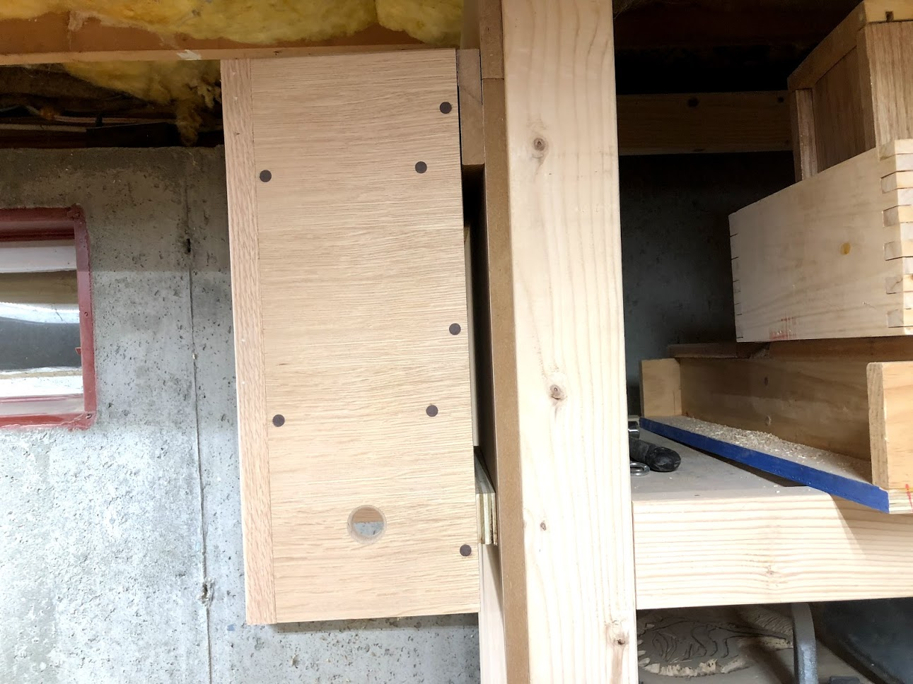 "Here is he French cleat closed off, with the mating cleat on back of the unit and closes the cleat off so it doesn't move. I also placed a 3/4"" thick piece of plywood on the bottom of the unit to negate the need for the unit to lean forward and be plum on the wall."