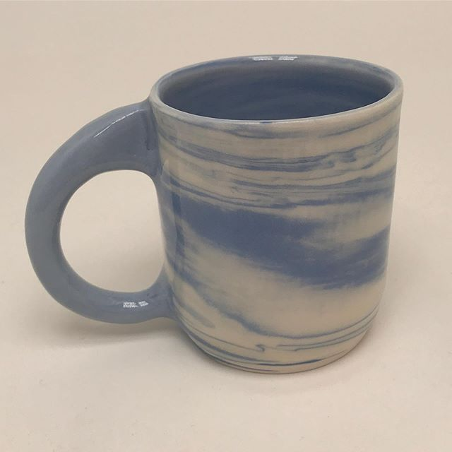 💙 This is a mug I made 💙  #potterehh #pottery #ceramics #functionalpottery #porcelain #porcelainmug #mugshot #clay #bklyclay #pottersofinstagram #marbling #wheelthrown pottery