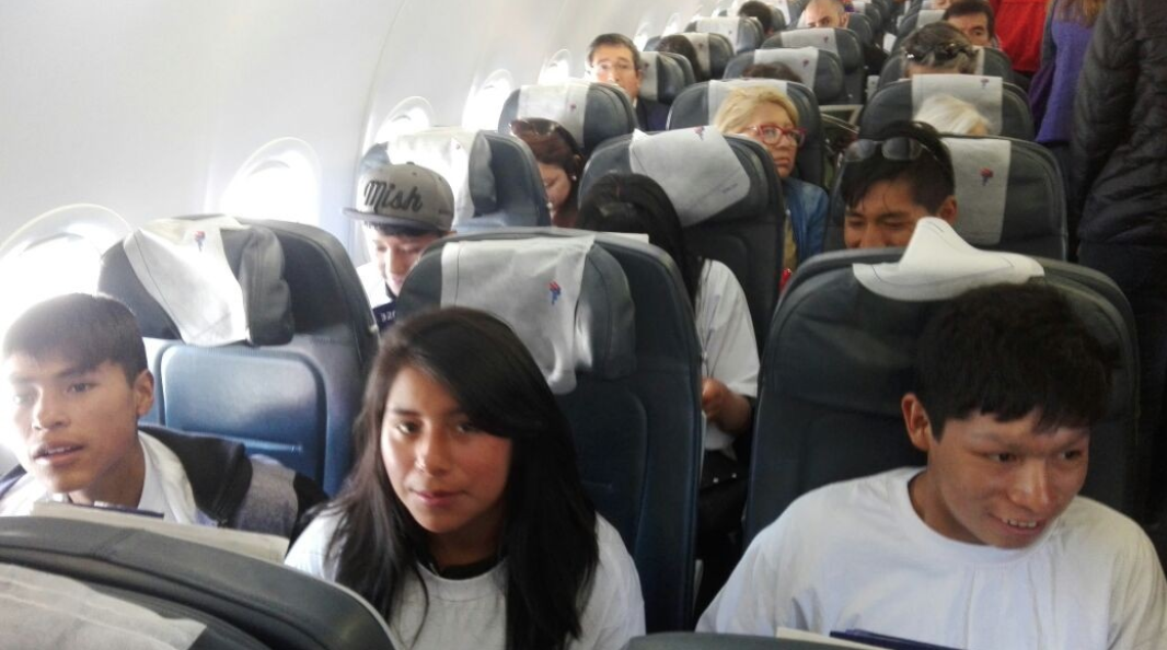Soledad, Eloy and Juan Dios sit on a plane for the first time.