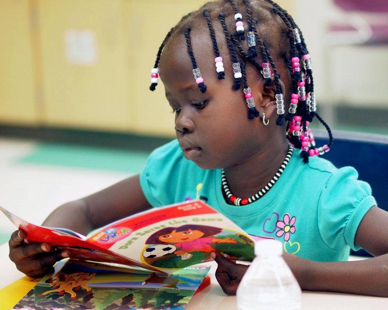 girls w beads and book sat bridges.jpg