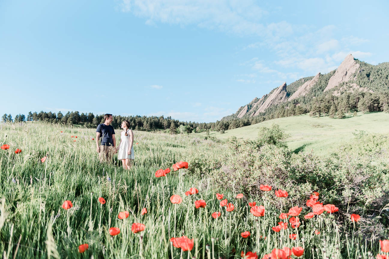Chautauqua Park sunrise engagment session in Boulder, Colorado. This hiking engagement session was so fun and filled with wild flowers, sunrise, picnic blankets, lush open fields and dancing.