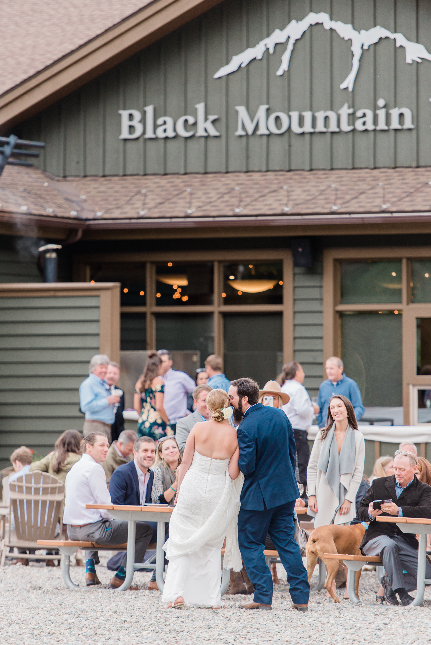 Ashleigh Miller Wedding Photographer captured a summer high alpine mountain wedding at Arapahoe Basin at Black Mountain Lodge in the Colorado mountains. This wedding was filled with dogs, wildflowers, love, mountains and joy!