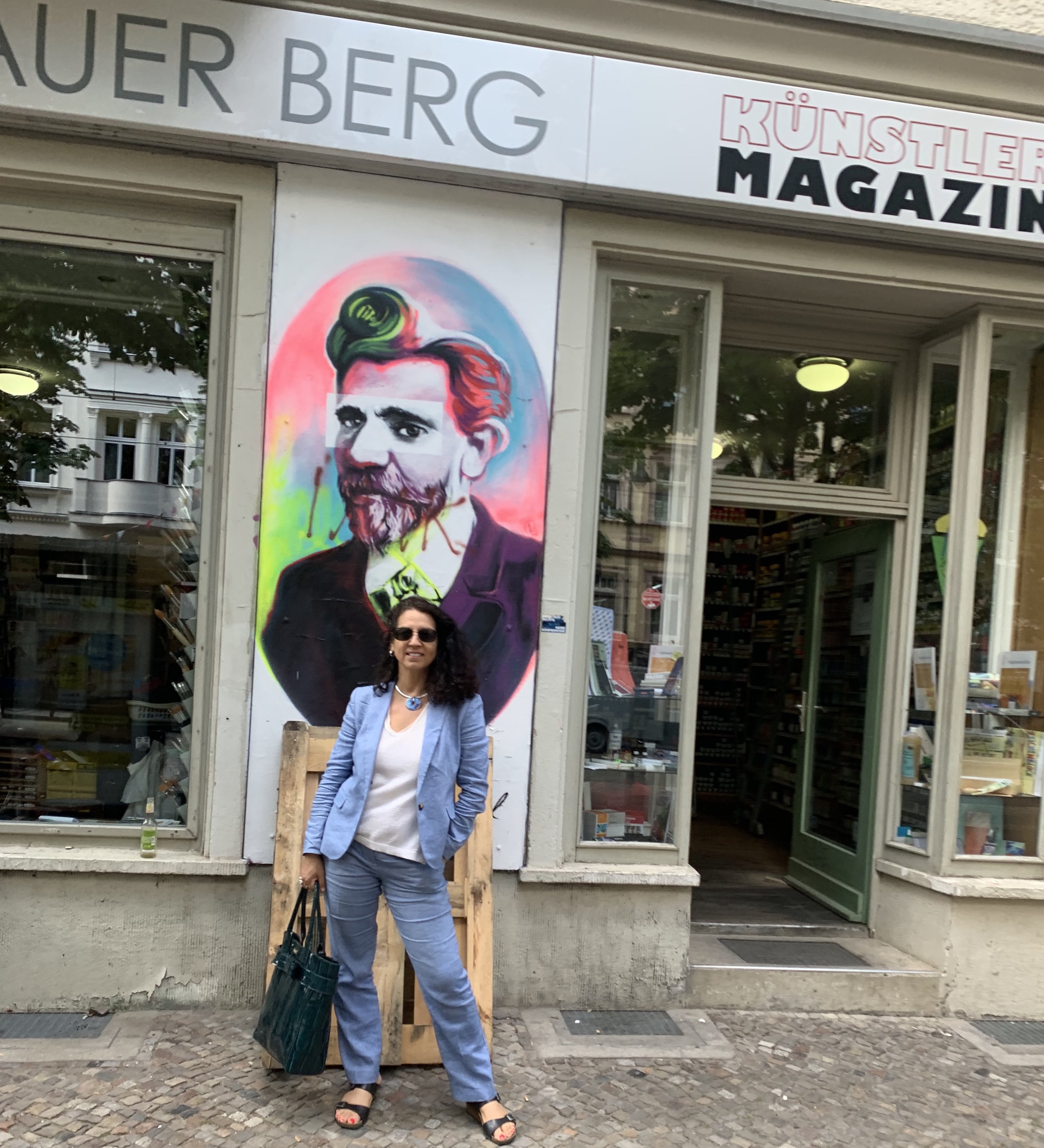 In front of a portrait of August Bebel in Prenzlauer Berg.