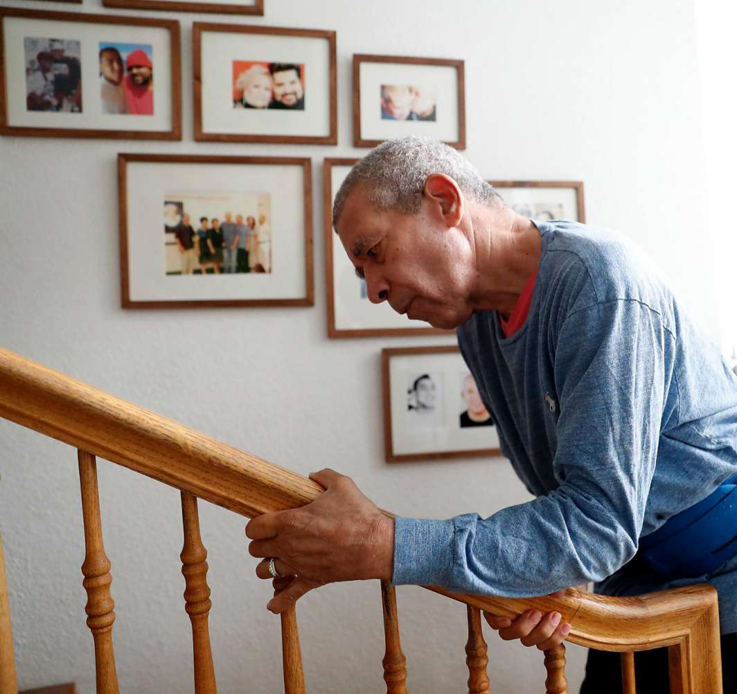 *Click image or this link to read more;  John Clark and his husband, Clark Russell, head upstairs at their home in Concord. Clark, who has Parkinson's disease, has undergone stem cell therapy in Mexico. Scott Strazzante, The Chronicle.