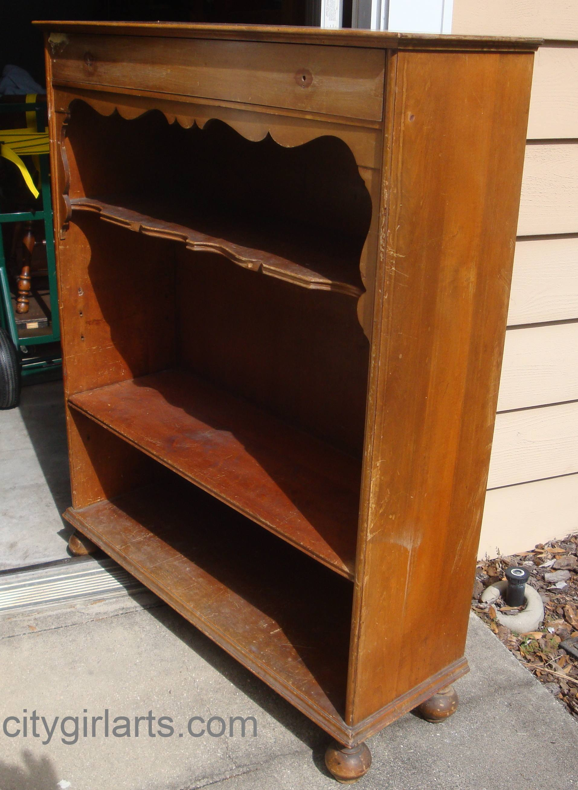 bun footed bookcase before
