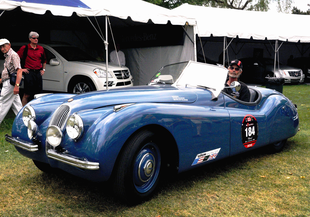Charlie drives XK120 #670150 up to take the Mille Miglia award. Waiting to take the award for The Most Outstanding Jaguar presented by jaguar Cars of NA is Drake Darrin and with John Fitch aboard his C type. John drove this very car to a race win at Watkins Glen a number of years ago.