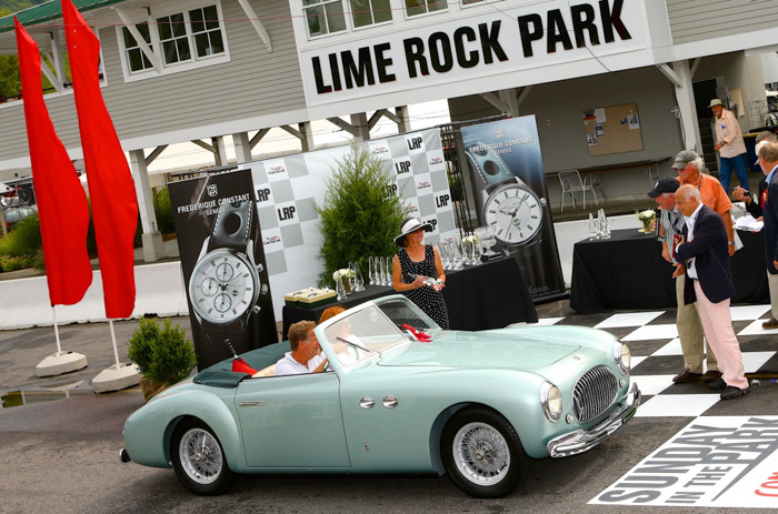 Andy Benenson and Elizabeth Jensen drive up for presentation of the award our honored collector Larry Auriana bestowed for the car he would most like to drive home