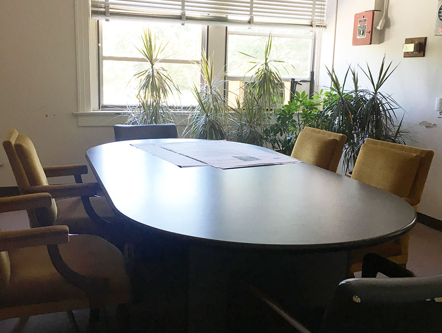 conference room - A light-filled room for small meetings, the table seats 8. 4 Hour Half Day - $258 Hour Full Day - $40Security Deposit - $125