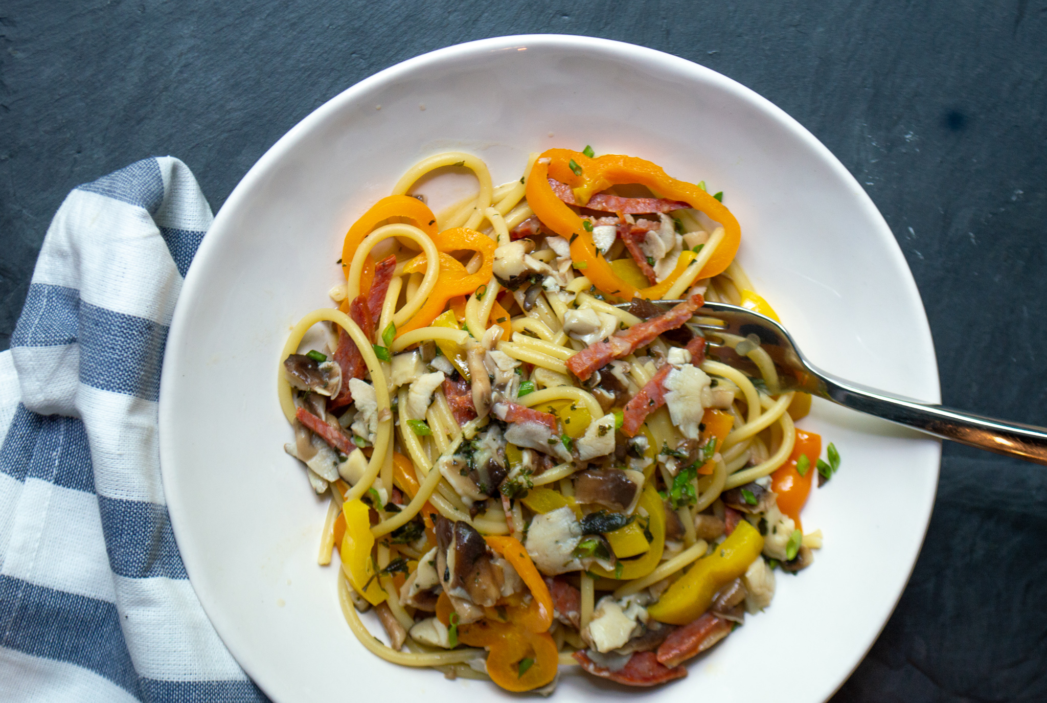 pasta with peppers, mushrooms, salami and chives