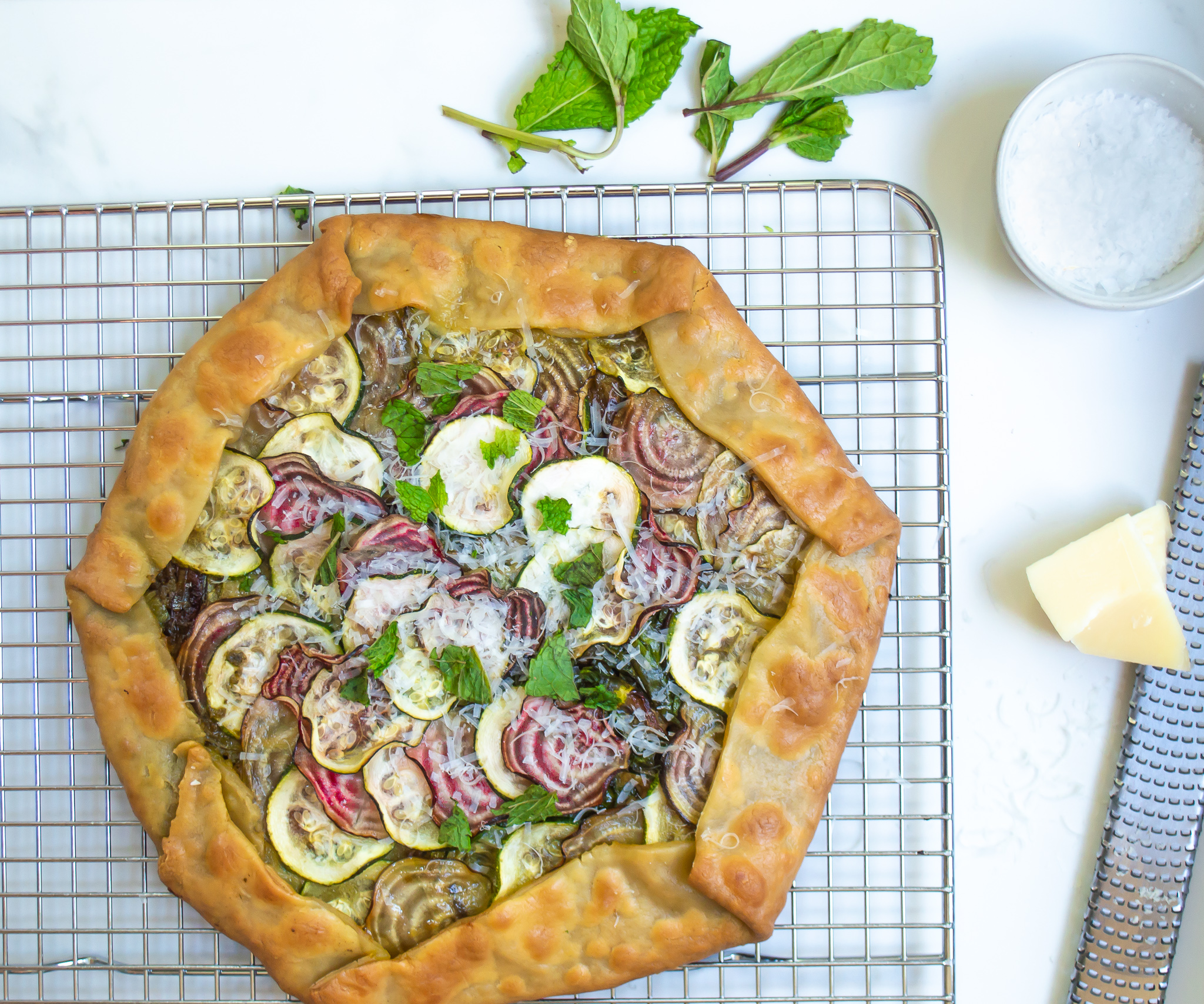 savory galette with beets, zucchini and parmesan