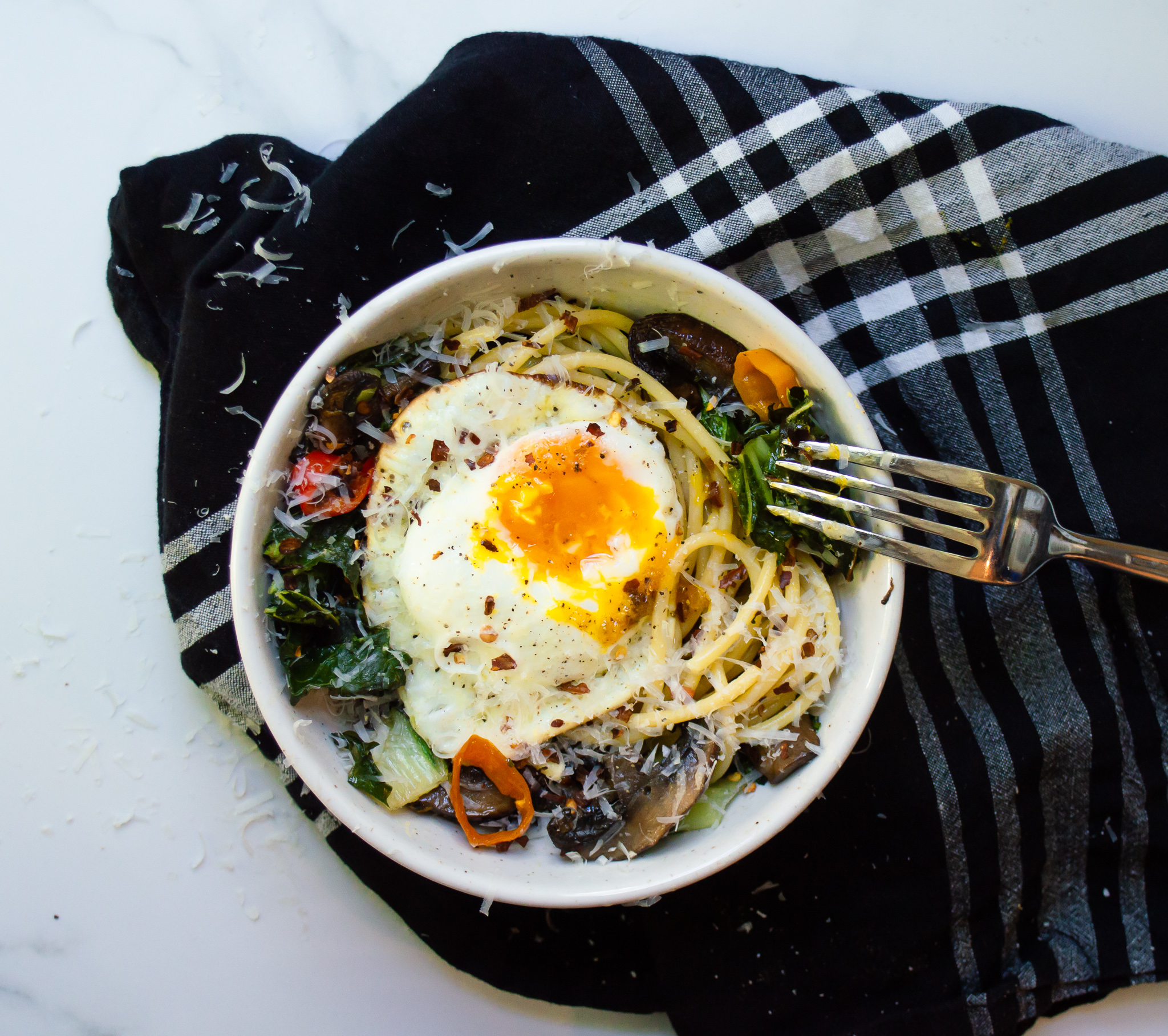 My firm belief: pasta is always better if you #putaneggonit. Add some leftover roasted veggies, like mushrooms, peppers, and bok choy, and you've got my favorite breakfast.