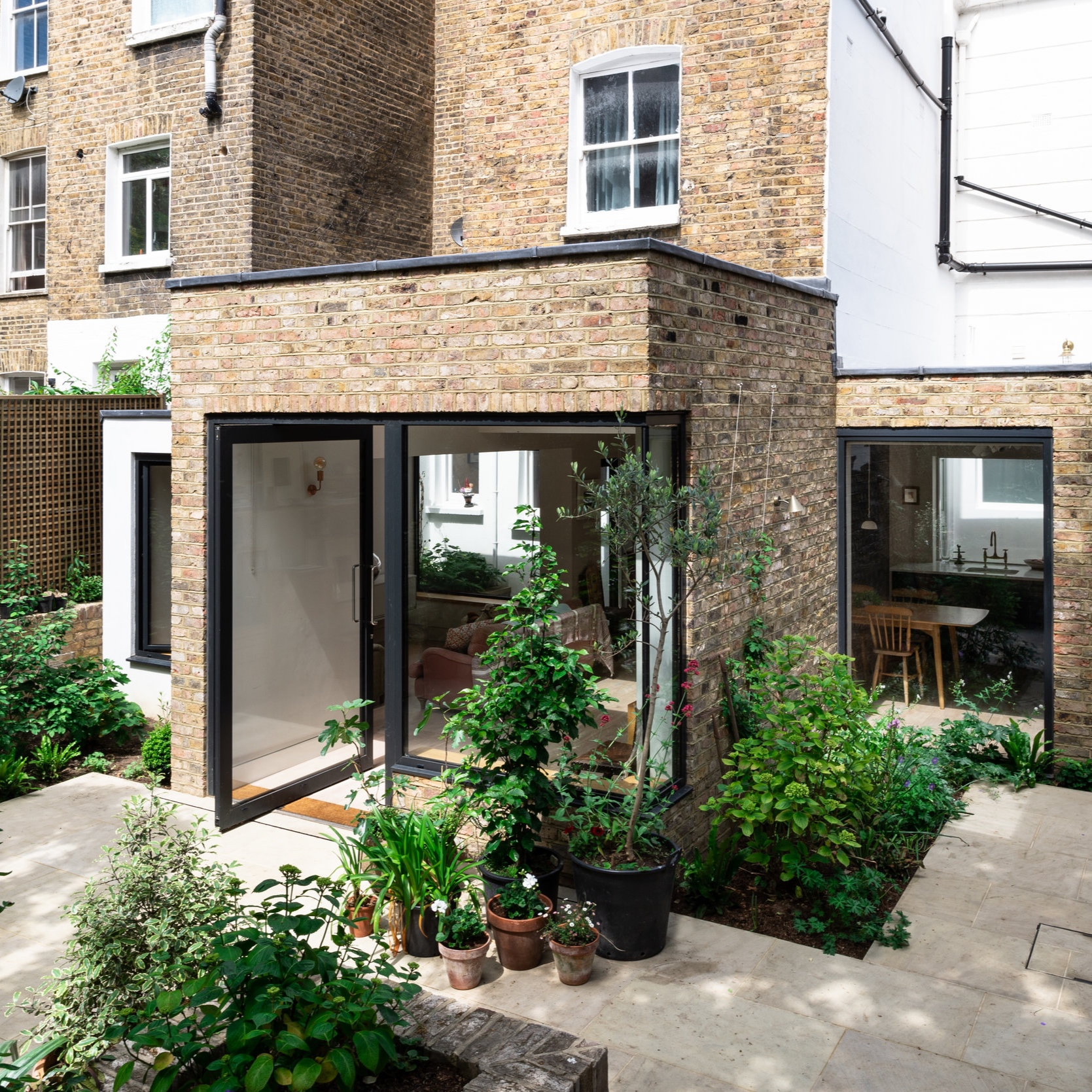 ELGIN AVENUE   a light filled family home within a secluded sunken garden in Maida Vale.