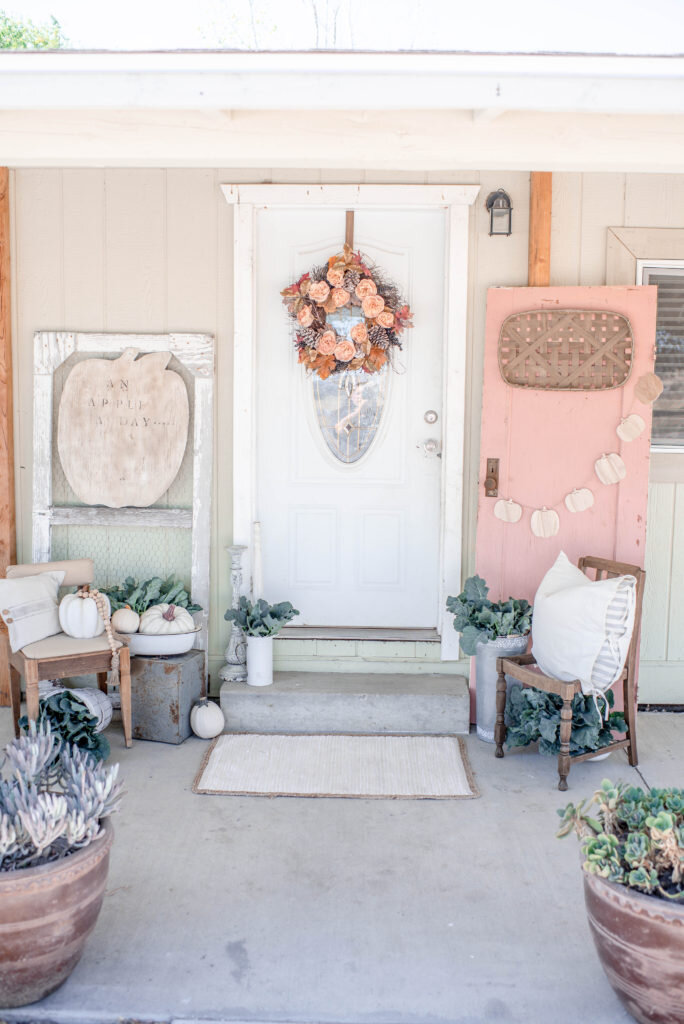 here is fall porch inspiration with a beautiful pink door from Corey at Hudson Farmhouse    https://www.hudsonfarmhouse.com/pink-fall-front-porch-decor/