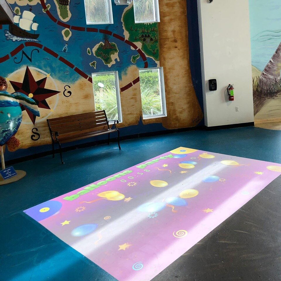 - ALL NEW! Located in the Explorer's Gallery, Our Beam Exhibit is a projector screen that displays on a large floor canvas. The Beam contains dozens of interactive games for all ages. It is a terrific display of technology and promotes exercise and movement.